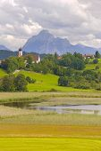 picture of bavaria  - landscape in Bavaria with alps mountains and a little lake nearby church of city Seeg - JPG