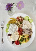 foto of ouzo  - variety of greek appetizers ouzo meze on table - JPG