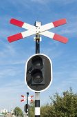 stock photo of railroad-sign  - railroad crossing sign with warning lights in Rotterdam - JPG