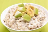 picture of porridge  - Porridge oats with apple and bananas slices close up view - JPG