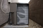 Постер, плакат: Air Conditioner Outdoor Unit In Winter