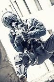 stock photo of officer  - Spec ops police officer SWAT during rope exercises with weapons