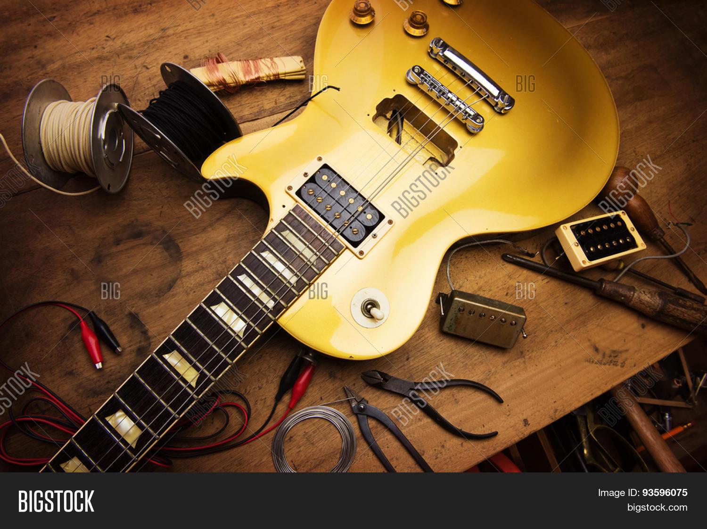 Electric guitar repair. Vintage electric guitar on a guitar repair ...