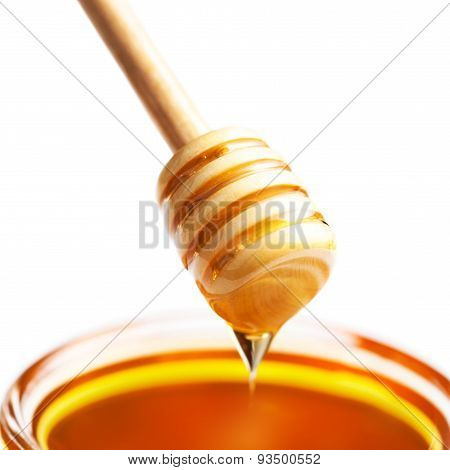 ..honey Dipper With Honey In Jar Isolated On White Background Macro.