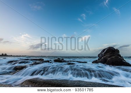 Water rushing over rocky shoreline