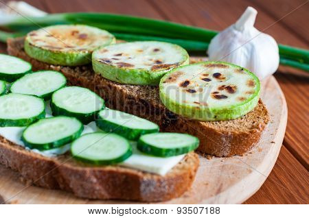 Open Sandwich With Butter, Cucumber Grilled Vegetable Marrow, Green Onion And Garlic In Rural Or Rus