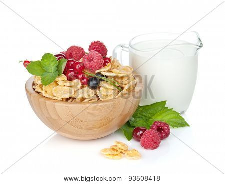 Fresh corn flakes with berries and milk jug. Isolated on white background