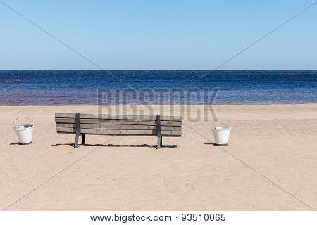 Wooden Bench On The Sandy Beach Seashore