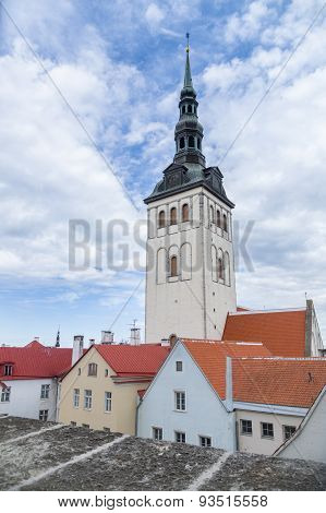 St. Nicholas' Church And Tiled Roof Houses View, Tallinn, Estonia
