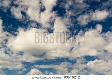 Wispy White Clouds Against Dark Blue Sky