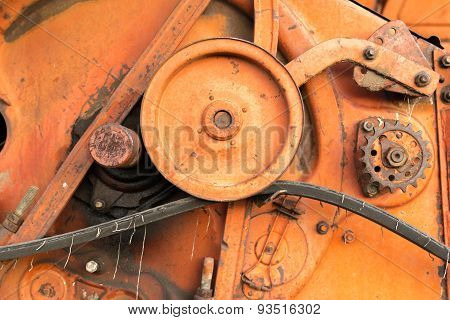 Close-up Of Old Red Harvester Cogs