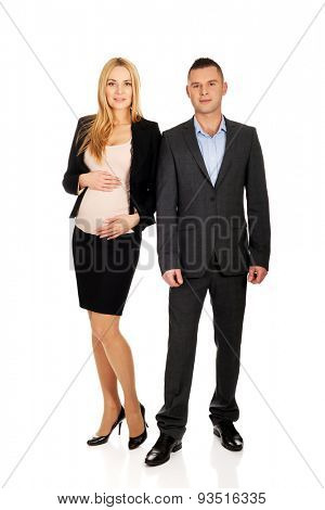 Working pregnant woman with her businesspartner