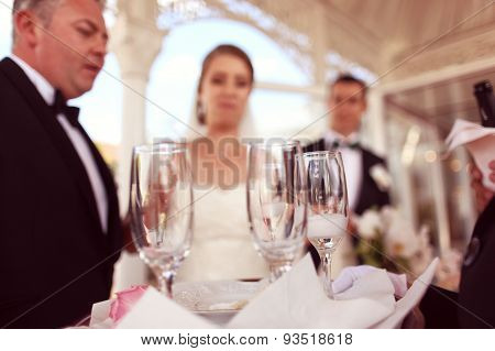 Bride And Groom On Their Wedding Day Celebrating With Champagne