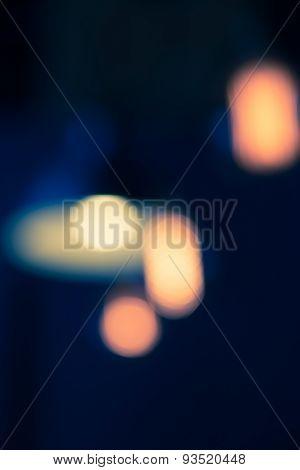 Defocused Bokeh Of Lamp In Dark Tone Vertical Background