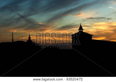 Silhouette Of Old Town And Fortress Tower At Sunset