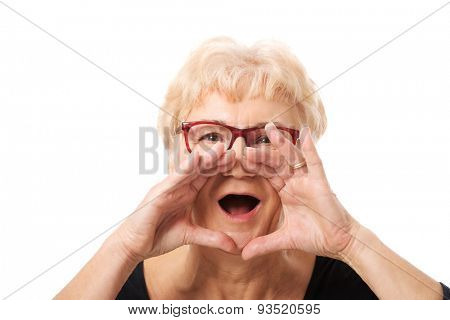 Senior woman calling for someone