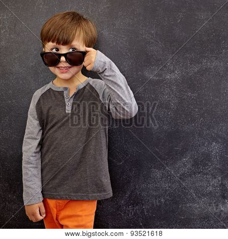 Cool Boy Peering Over His Sunglasses At Copy Space