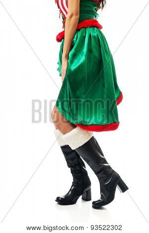 Slim woman legs wearing elf boots.