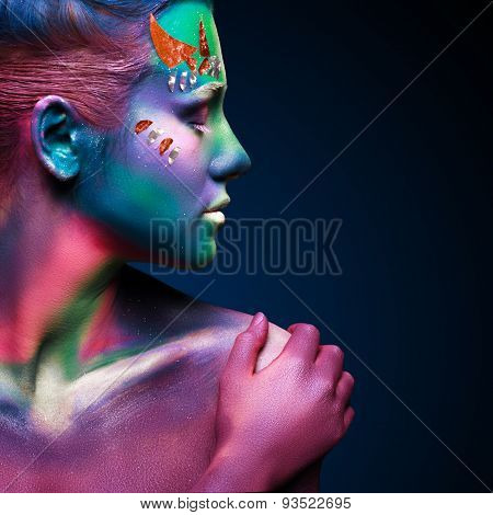 Portrait of beautiful woman with body art