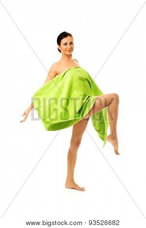Happy laughing wrapped in towel with leg up.