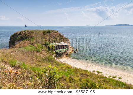 Wild Beach With Small Abandoned Restaurant