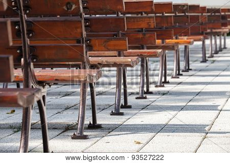 Empty Wooden Benches In A Row, Open Air