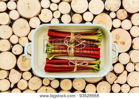 Rhubarb - fresh rhubarb on a wooden background