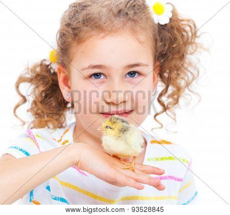 Girl holding baby chicken