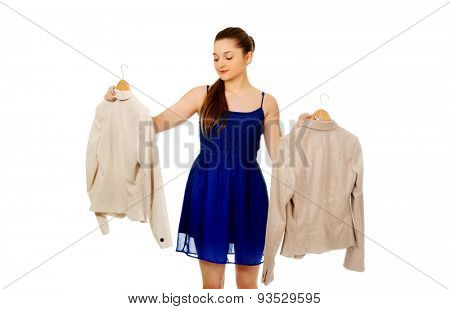 Teenage woman in dress thinking what to wear.