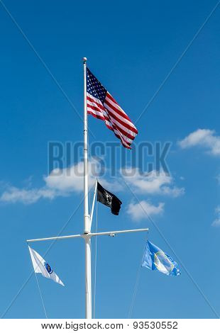 American And Pow Flag On White Mast