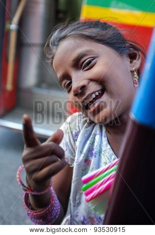 MUMBAI, INDIA - 11 JANUARY 2015: Indian child on streets of Mumbai selling pens.