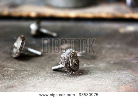 Small metal brush on table close up