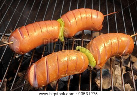 Tasty Sausages On The Hot Barbecue Charcoal Grill Close-up
