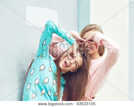 two girlfriends are hugging and having fun