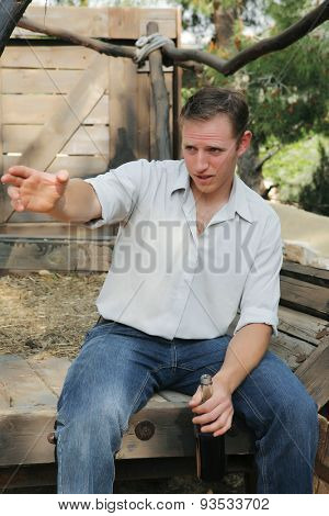 young happy white Caucasian man taste and enjoy red wine outdoor in in countryside