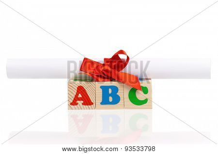 ABC formed by wood alphabet blocks with diploma, isolated on white background