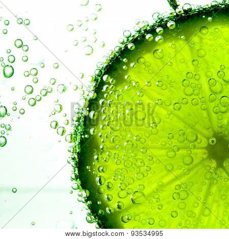 Lime Slice in Clear Fizzy Water Bubble