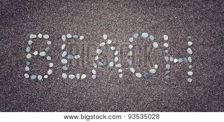 'beach' Word On The Sand. Written With Pebbles. Aged Photo.