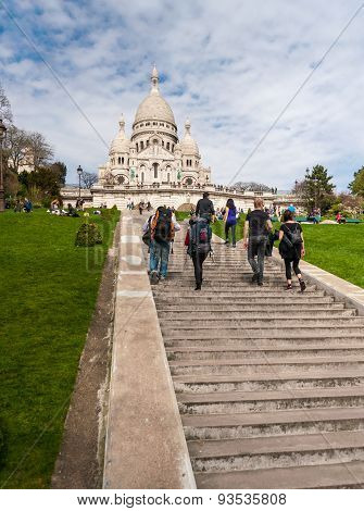 Tourists Stroll In Montmartre Near Basilica Sacre Coeur