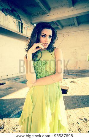 Beautiful Model In Green Dress Posing In Grunge Location