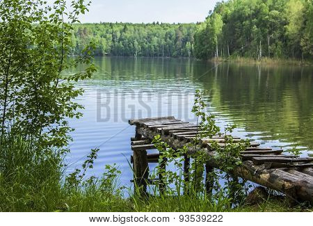 landscape with a lake, forest and walkways