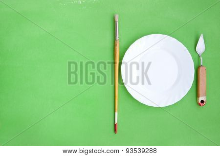 Background With Painting Instruments And A Plate