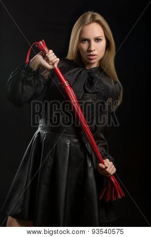 girl with red leather whip