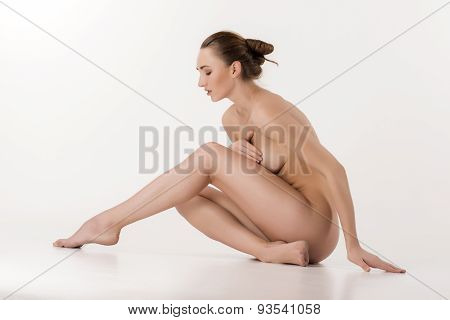 Beautiful caucasian naked woman sitting with fresh clean skin