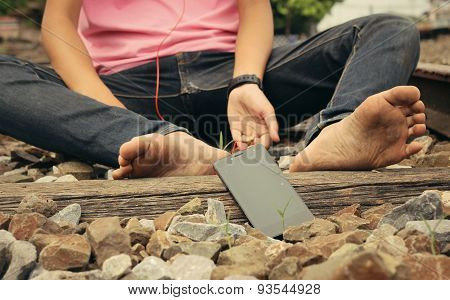 Bare Feet On The Railway  With Smartphone
