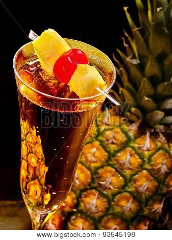 Champagne  cocktail with cherry and whole pineapple with leaves . Cocktail card 69