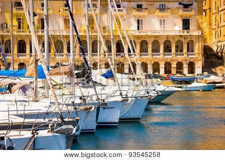 a number of yachts in a bay near Valletta in Malta