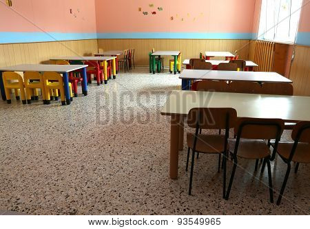 Refectory Of The Nursery With Colorful Chairs And Dining Tables