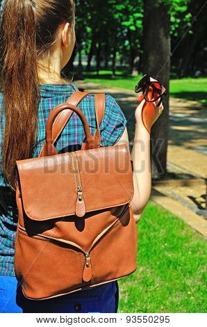 Young Woman With Stylish Rucksack And Sunglasses