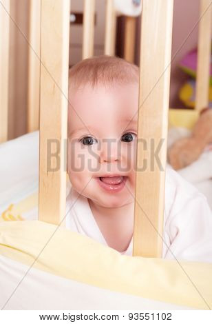 Baby Lies In The Crib Bed